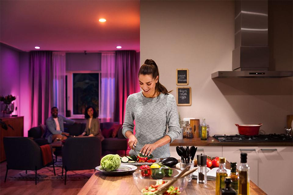 Philips Hue in comfortable kitchen and lounge setting with ambient light.