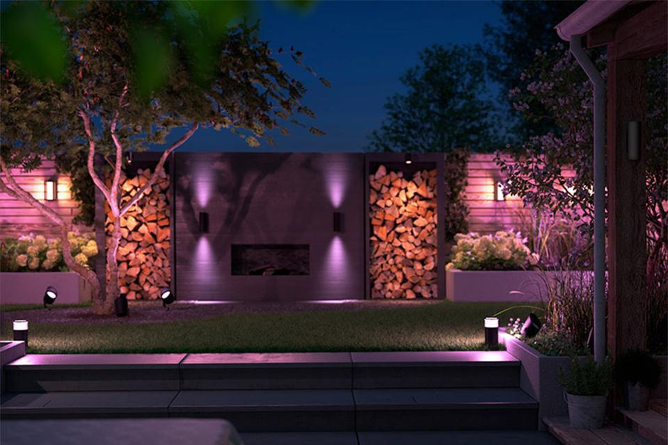 Different Philips Hue garden lights in purple showcasing outdoor ambiance.