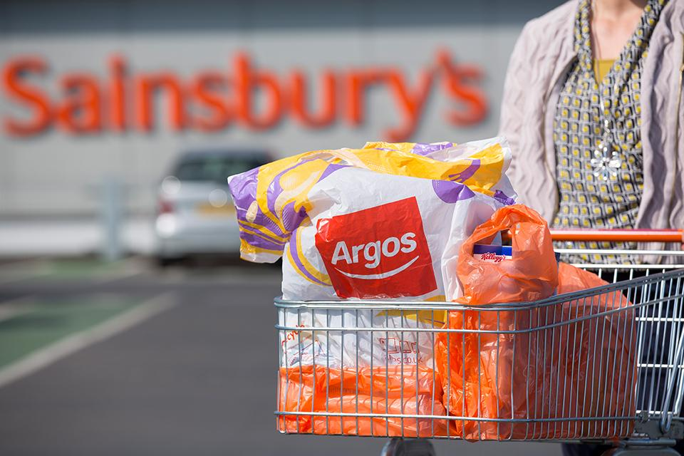Trolley with an Argos bag outside a Sainsbury's store.