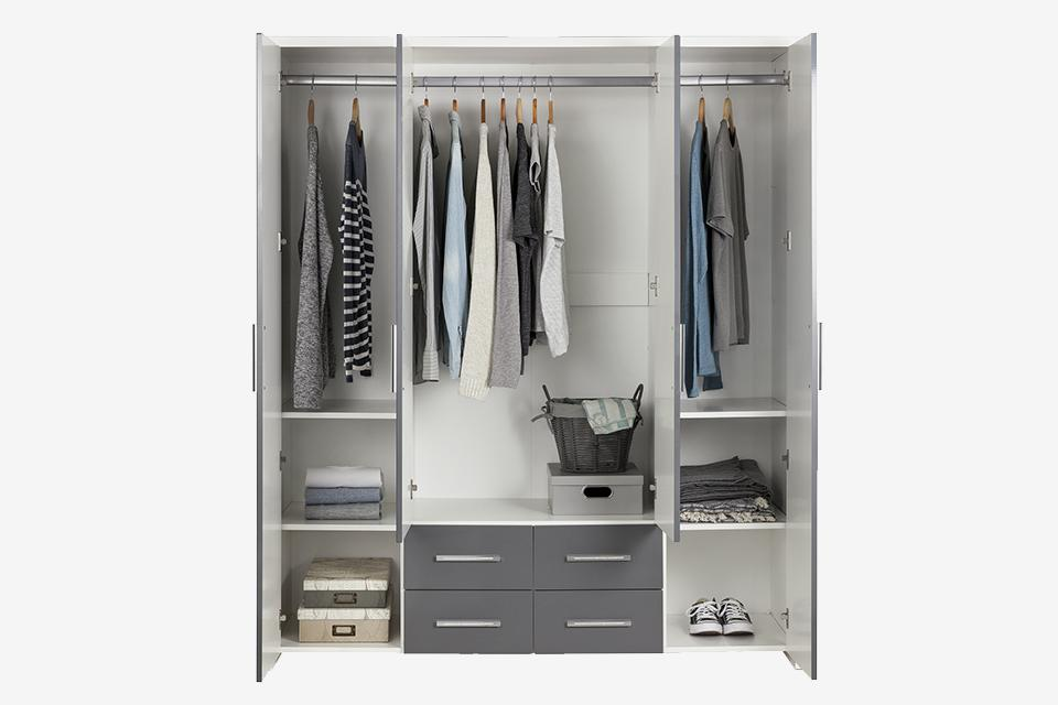 Triple wardrobe with clothes and shoe storage.