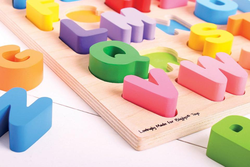 Close up of wooden alphabet puzzle
