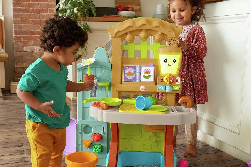 Boy and girl playing with activity table