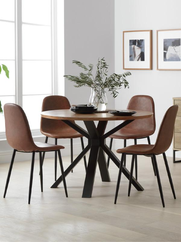 Dining room with round table and 4 chairs.