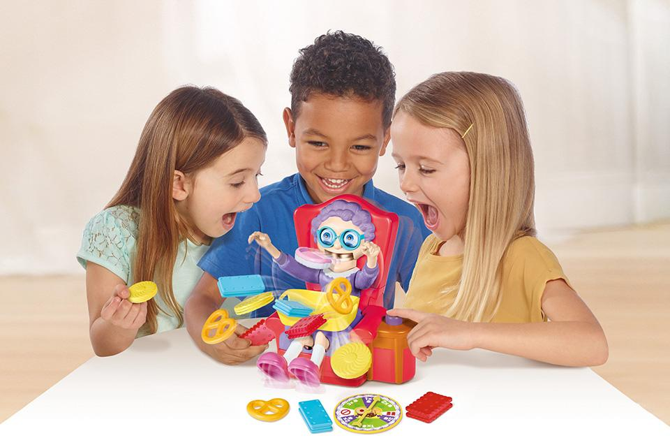Three kids playing a board game.