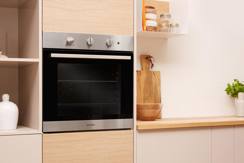 Built-in eye-level single oven in a light kitchen setting.