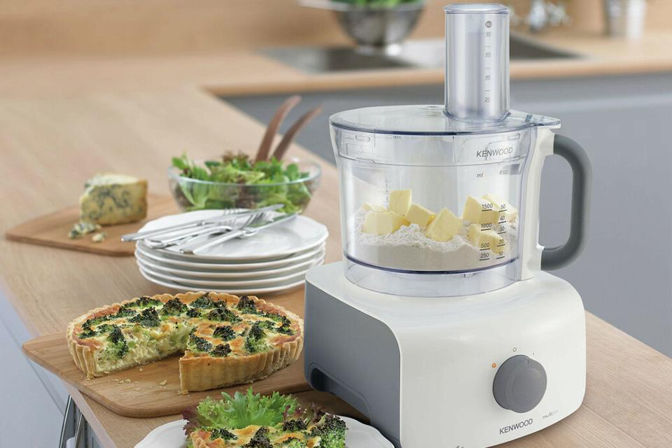 Food processor next to a quiche.