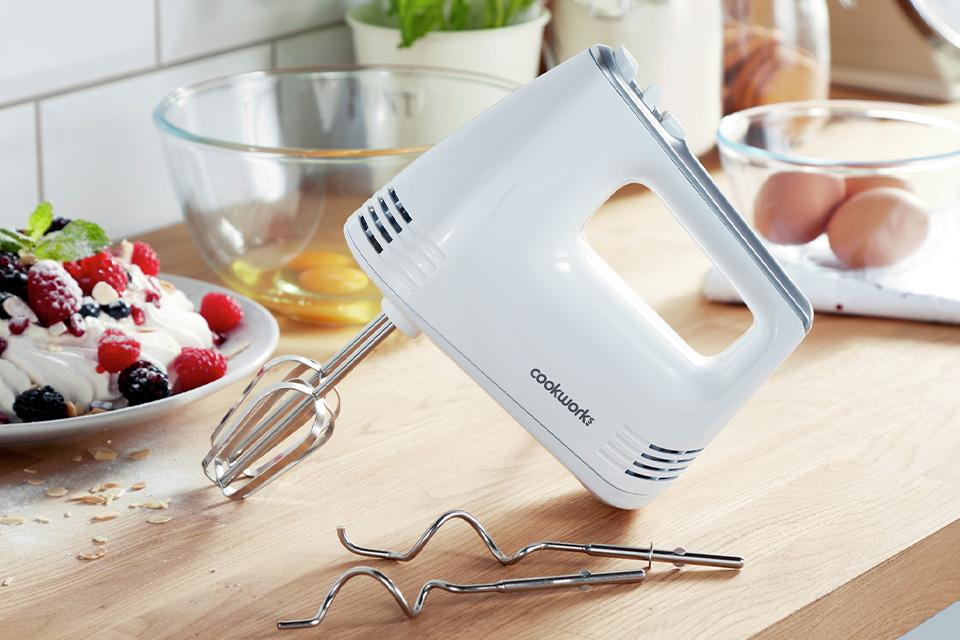 Hand mixer on kitchen side.