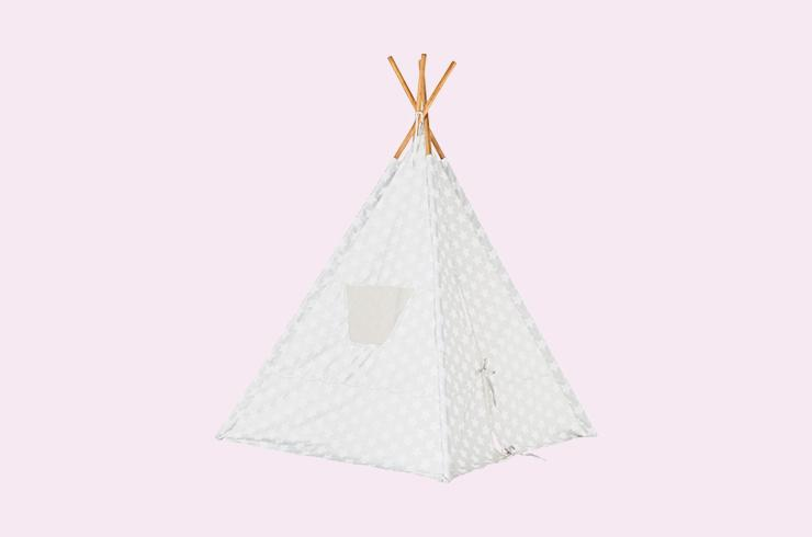 A silver teepee tent patterned with white stars.