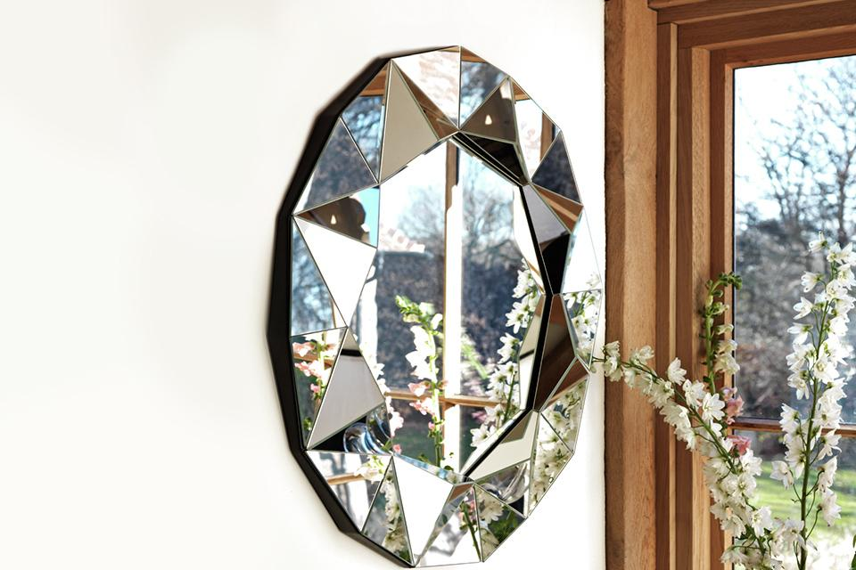 Argos Home Ebury silver round faceted wall mirror.