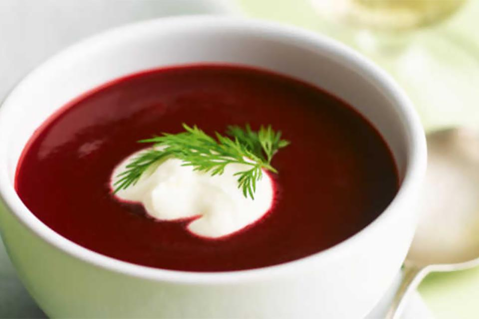 Prepared beetroot soup with garnish.