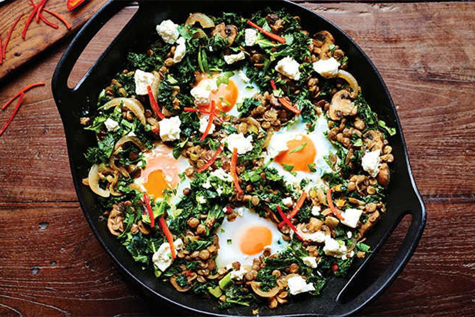 Prepared lentil and egg dish in pan.