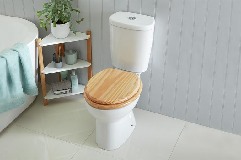 A wooden toilet seat in a bathroom scene.