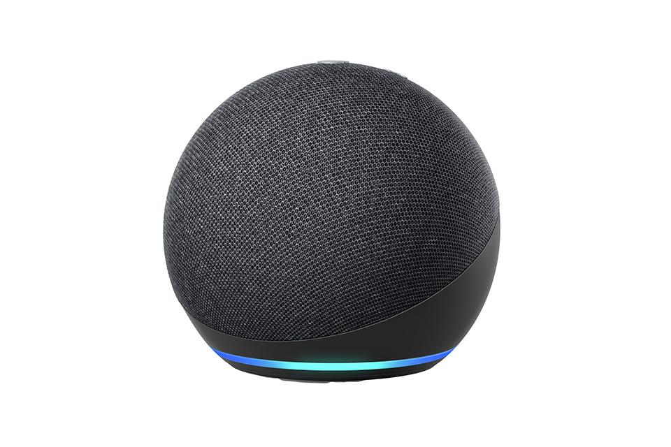 A round, black version of the Echo Dot speaker.