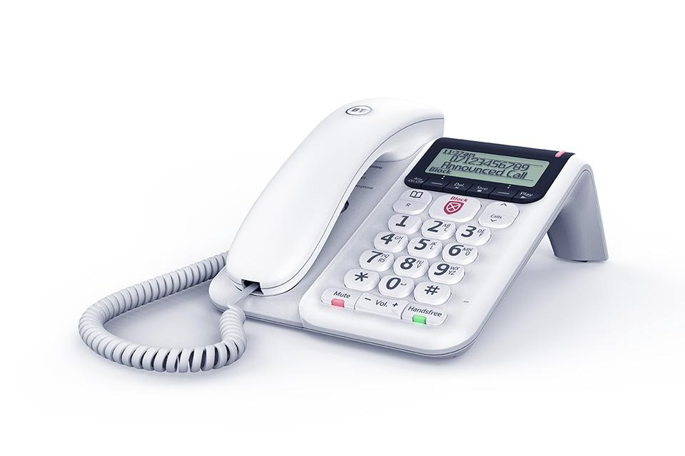 A white BT corded phone sits on a white background.