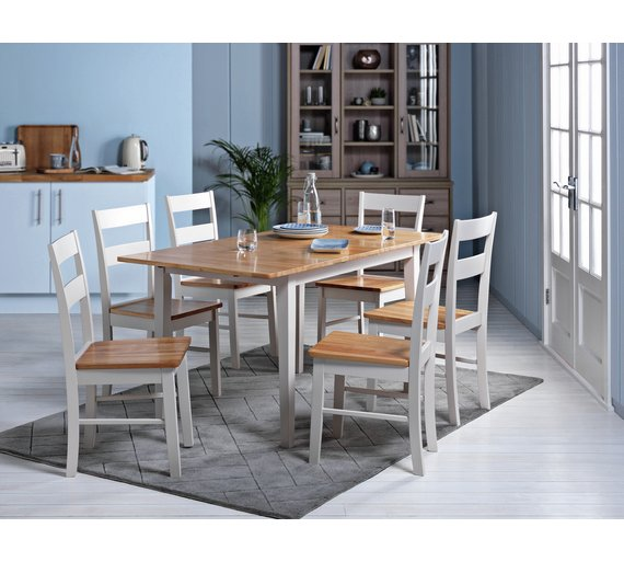 Extendable Dining Table With Plates Cutlery And Glasses