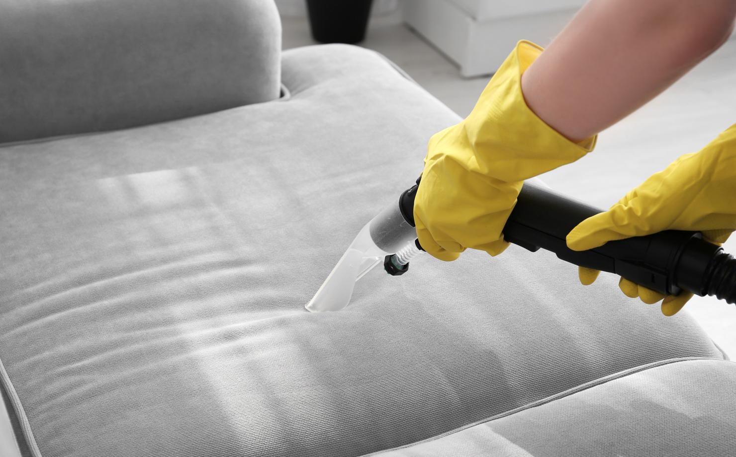 Steam cleaning upholstery.