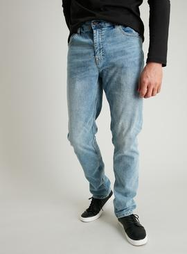 Light Wash Denim Tapered Fit Jeans With Stretch